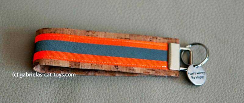 Schlüsselanhänger Reflektorband orange mit Anhänger Smilie